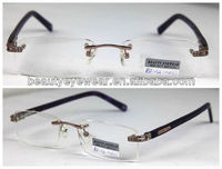 High quality and factory direct sale rimless woman metal glasses with spring hinge and clear stones