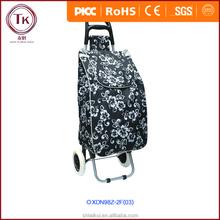 Portable shopping cart black color with white flowers two wheels