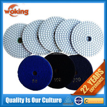 Wet grinding pads for metal