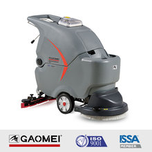 Walk behind electric pavement sweeper with floor brush