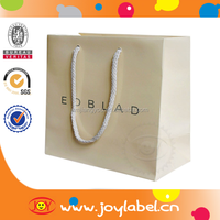 2015 New design custom paper bag with swing tag