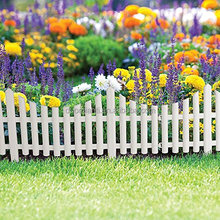 Wood effect plastic garden fence for plant