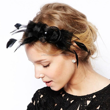 Fancy ladies black bow feather fascinator
