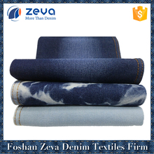 Alibaba China in-stock blue colored 100% cotton denim fabric high quality for jeans