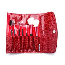 Wholesale pu leather bright red rolling makeup bag contents bush cosmetic bag