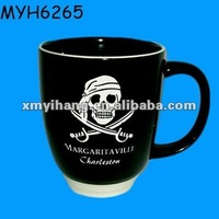 Black ceramic coffee mugs with pirate skull painted