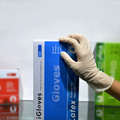 Hospital medical cheap latex gloves made in Malaysia