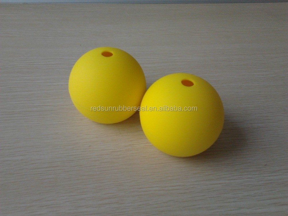 solid Rubber Ball with hole for dogs