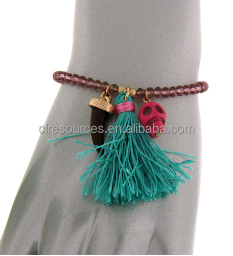 hot wholesale Bead bracelet a horn and skull charm along with a frilly string in the middle