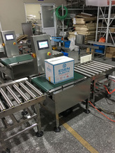 heavy-duty, in-motion, check weight conveyor designed Checkweigher to weigh large and heavy products of any shape or size