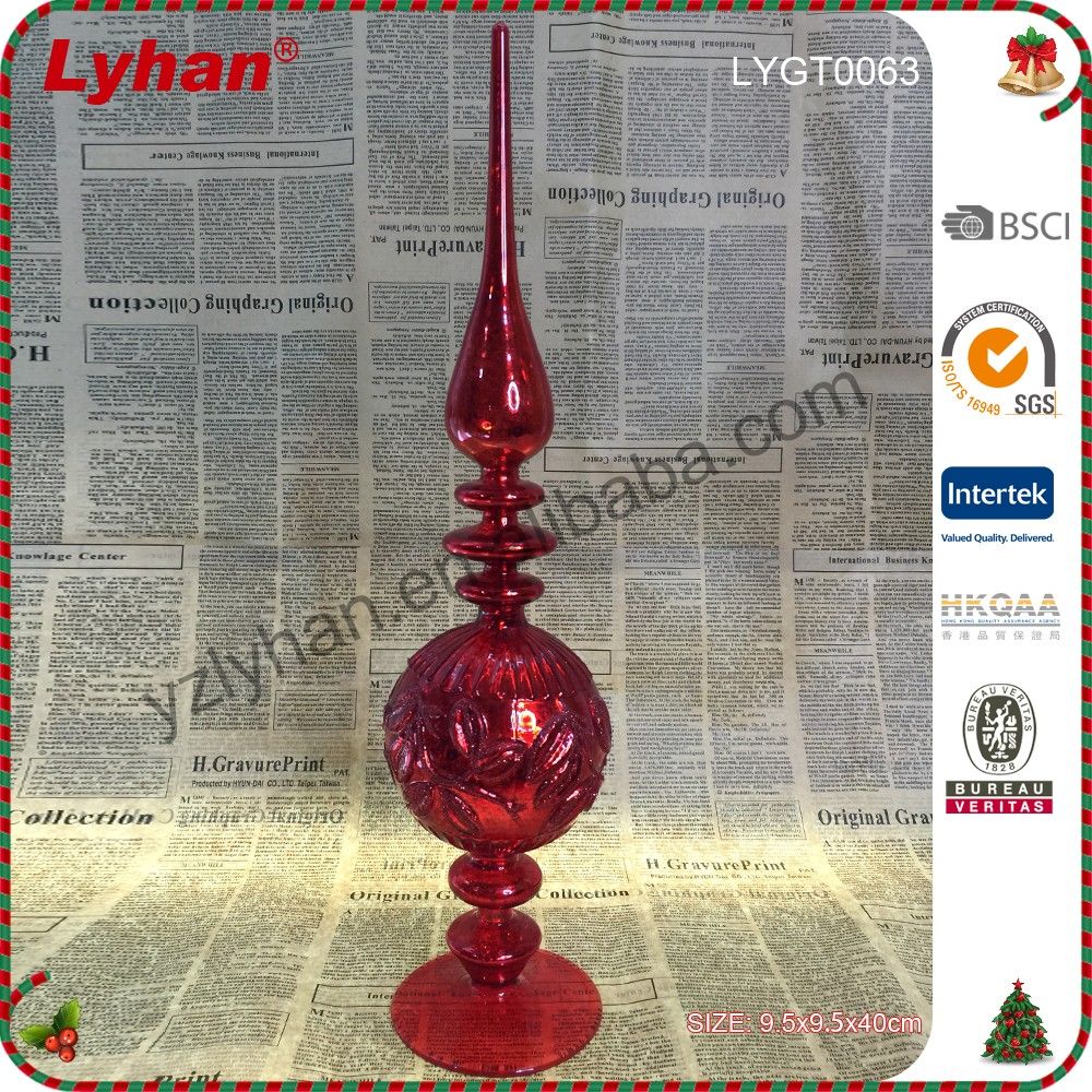 red glass tree topper as spire for Christmas home decoration