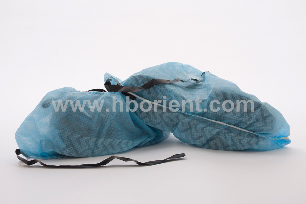 Disposable anti slip ESD shoe covers