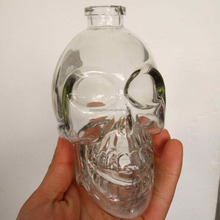 food grade food container manufacture skull shape wholesale wine empty glass bottle