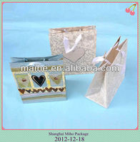 Paper gift bag with ribbon handle