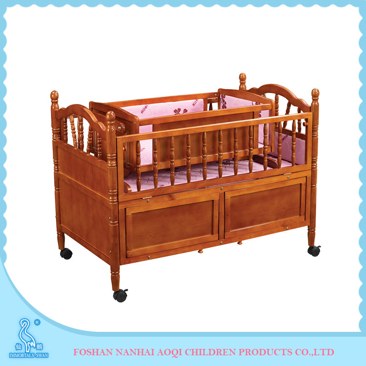 Solid pine wood baby crib with storage drawers and wheels