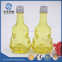 wholesale cheap unique shape 40ml yellow glass wine bottle with screw top