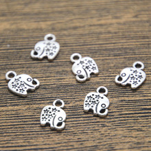 mini elephant silver tone 2 sided elephant charm pendant 11x8mm