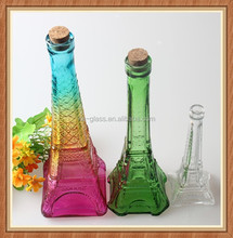 China factory exporter 350ml fancy eiffel towel color clear glass bottle decoration with stopper for perfume beverage and liquor