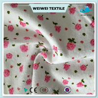 Low price light pink cotton printed flannel fabric for children