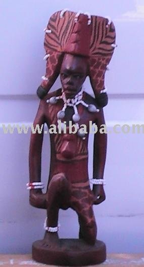 Hand carved kneeling Masai warrior sculpture