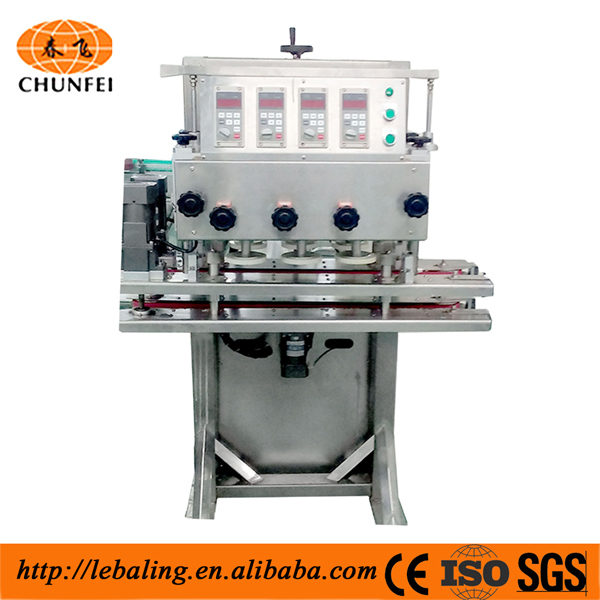 Liquid filling and screwing capping machine