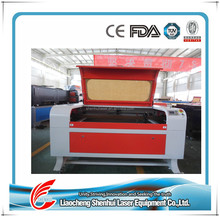 Applicable for garment industry 1200 * 900 mm garment laser cutting machine equipment for sale