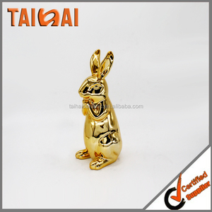 Ceramic decorative wedding gift with gold rabbit figurine
