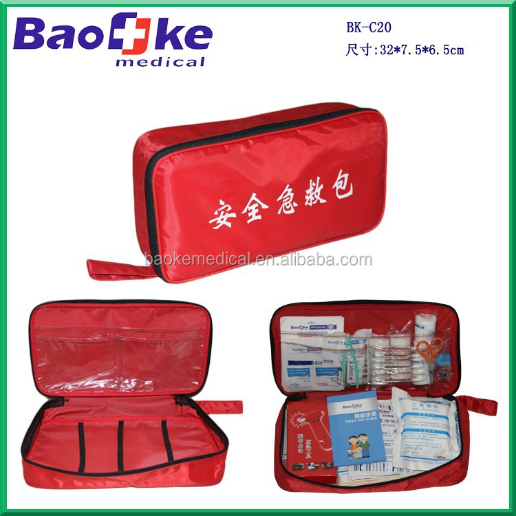 Roadside emergency first aid kit bag with flashlight and whistle