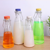 /product-detail/wholesale-factory-price-500ml-and-1000ml-milk-glass-bottle-60494674837.html