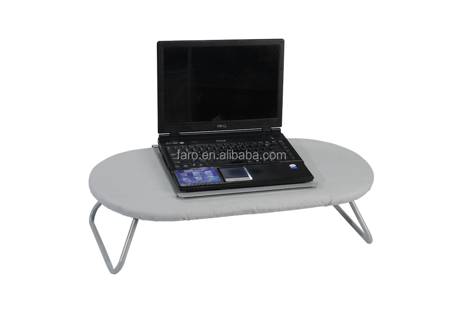 Folding laptop computer table on bed