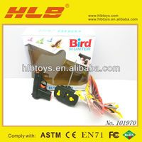Hot selling rc animated flying bird with shooting gun toy