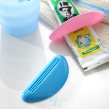 Simple convenient mini plastic tube dispenser toothpaste squeezer