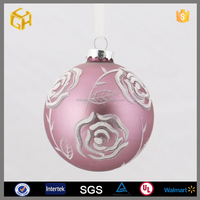 Rose in the Christmas glass ball for the wedding decoration