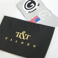 Custom high quality eco-friendly embossed reflective woven neck labels for knitting beanie hats