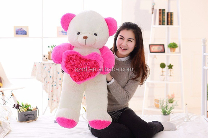 Hot sale new cute teddy bear holding beautiful flowers classical soft bear plush toy for loving heat gift