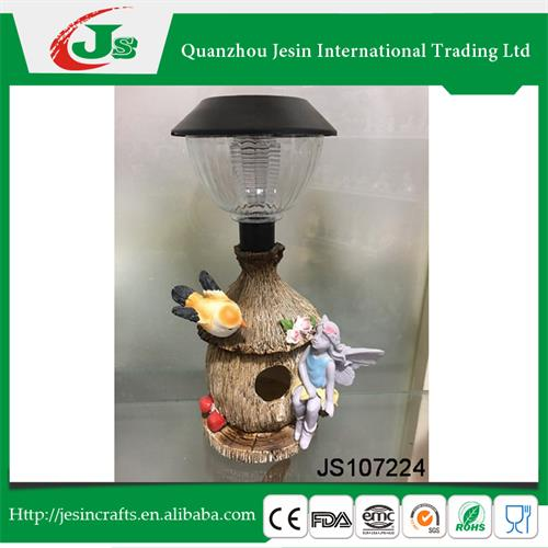 Resin bird house decoration with fairy and solar lantern, for decorating the garden