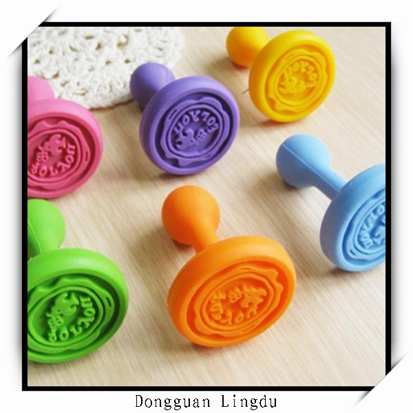 Rubber stamp handles and rubber stamp raw material
