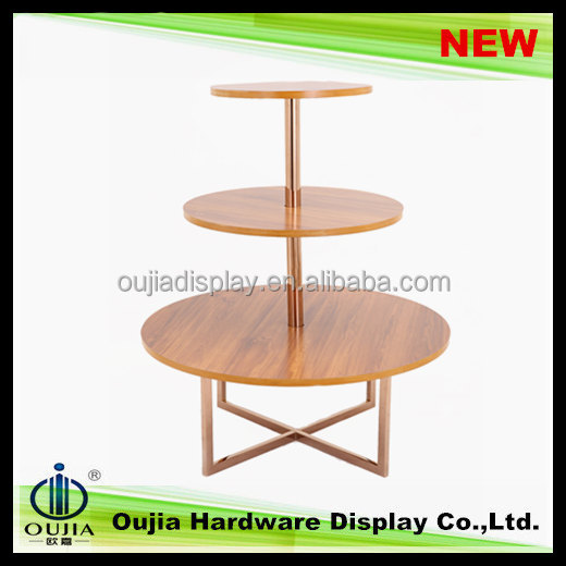fashion design garment showroom wooden furniture designs round table display clothes