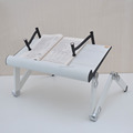 Folding adjustable laptop table with book clamping