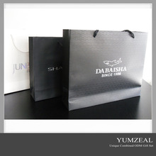 White logo printed black background paper carrier gift bags wholesale
