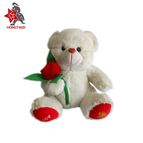 Factory direct sale New design plush toy teddy bear with flower