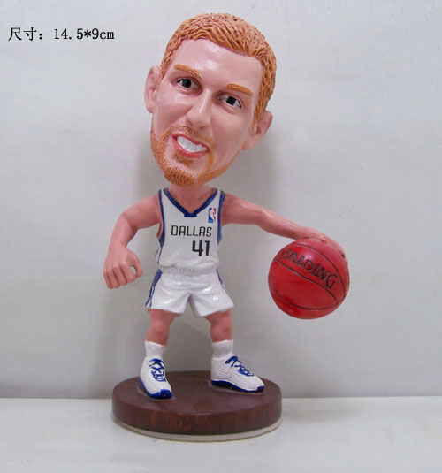 Basketball player bobble head figure