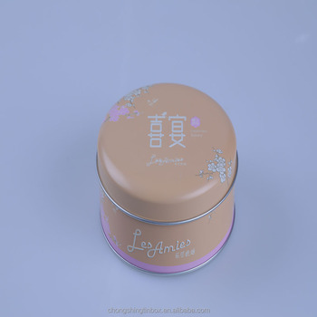 pink color round tin can and comestic tin box