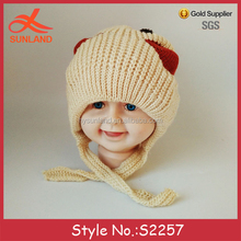 New design crochet patterns cheap knitted tassel kids beanie hats with two balls for sale