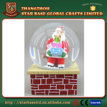 Fancy santa claus customized design factory resin christmas ball snowglobe, glass snow globe