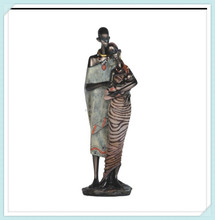 Polyresin african man holding women figurine