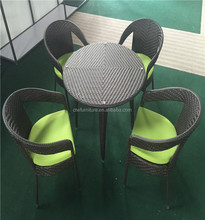 rattan armchair round table outdoor furniture