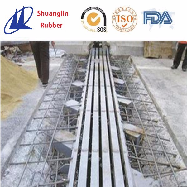 Modular bridge expansion joint for road or bridge
