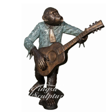 Life size outdoor bronze monkey statue
