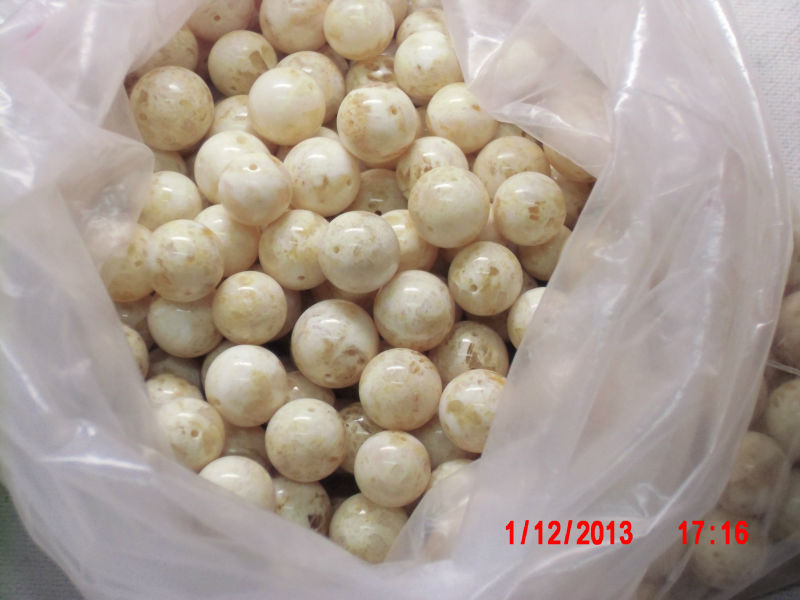 Reconstructed white amber beads